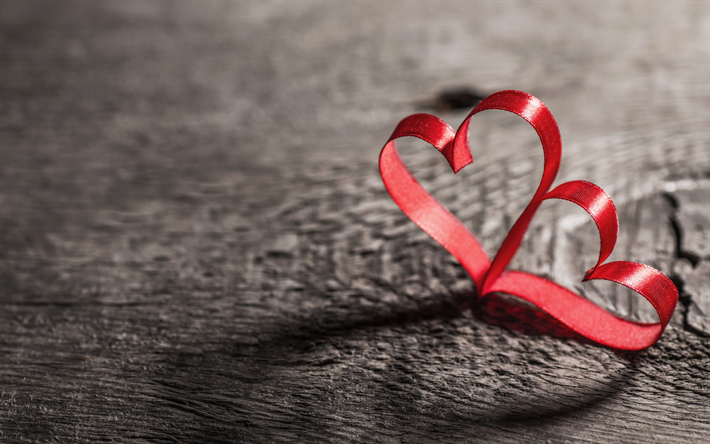 Valentines Day, two hearts, love concepts, red silk ribbons, red hearts