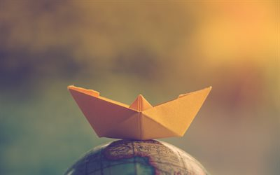 paper boat on the globe, travel concepts, tourism concepts, paper boat, travel around the world