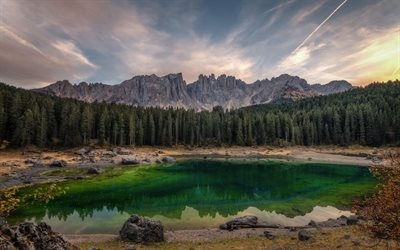 Emerald mountain lake, cliffs, Alps, mountain landscape, sunset, evening, mountains