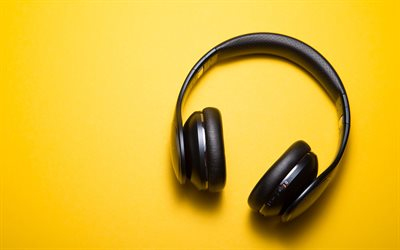 black headphones, yellow background, minimal, headphones