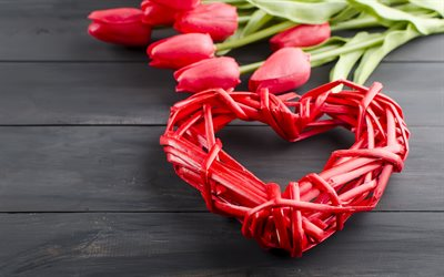 red woven heart, love concepts, heart of branches, red tulips, red flowers