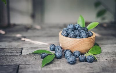 blueberries, forest berries, wooden plate, berries useful for eyes