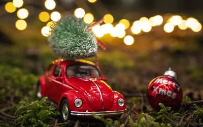 Christmas tree on a car, toy car with christmas tree, Merry Christmas, buying Christmas tree concepts, New Year