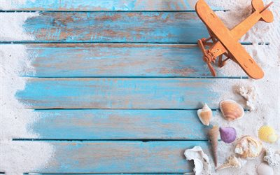 travel concepts, wooden plane, seashells, summer travel, blue boards, wooden background, sand