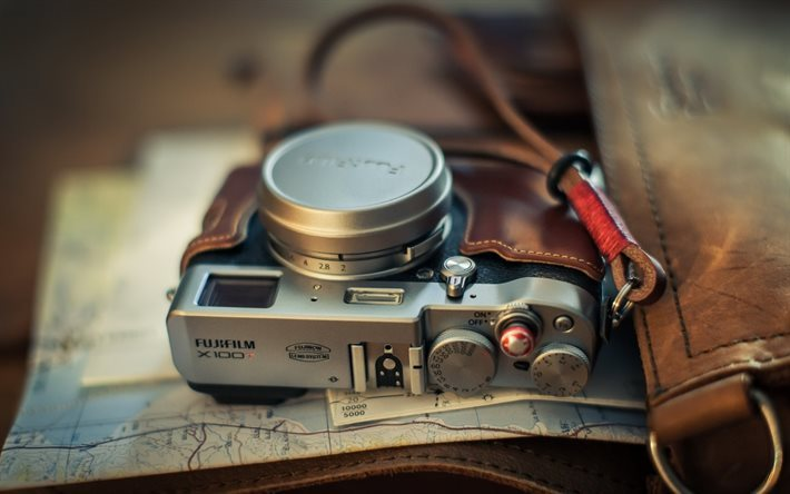 journey concepts, an old camera, a map, travel concepts, Fuji X100T