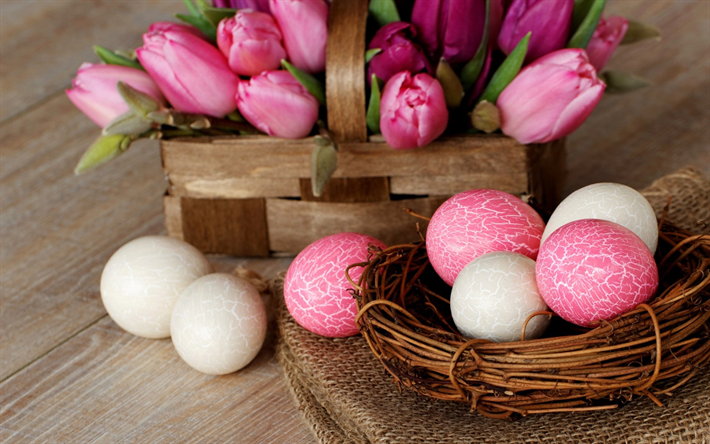Pink Easter eggs, spring flowers, pink tulips, a basket of eggs, Easter, creative Easter background