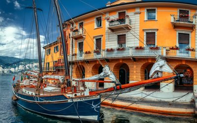 Malcesine, Lake Garda, wooden sailboat, mountain landscape, Italy