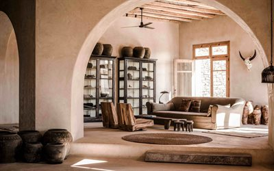 loft interior style, living room, old things in the interior, wooden beams on the ceiling, old clay jugs