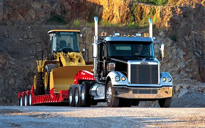 Freightliner FLD, truck transporting wheel loader, CAT wheel loader, CAT, Freightliner