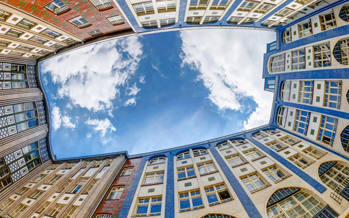Berlin, blue sky, bottom view, white clouds, old houses, Germany