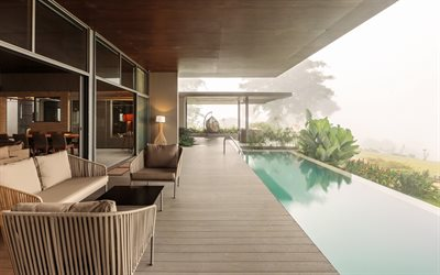 modern country house, pool on the terrace, wooden plank terrace, hanging metal chair, hanging chair ball, stylish pool design