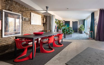 stylish interior design, dining room, red plastic chairs, red round vase, modern interior design
