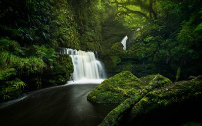 beautiful waterfall, Tautuku River, mountain river, Lower McLean Falls, cliffs, green moss, Catlins Forest Park, New Zealand