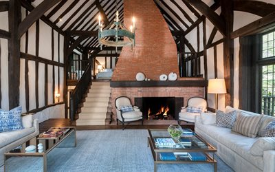 country house, living room, interior design, red brick fireplace, wood beams on the ceiling