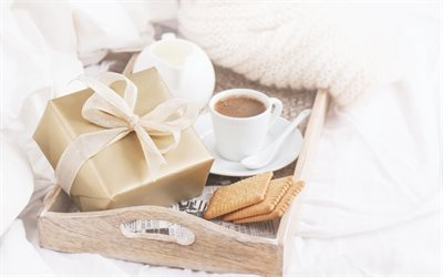 Romance, breakfast in bed, cup of coffee, gift box, cookies, breakfast