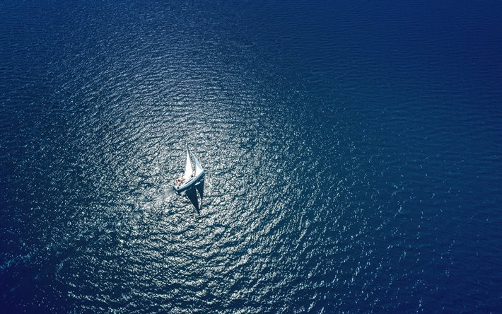 yacht at sea, view from above, sea, aero view, waves, white sailboat, loneliness concepts