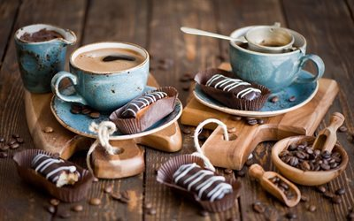 chocolate eclairs, coffee beans, cup