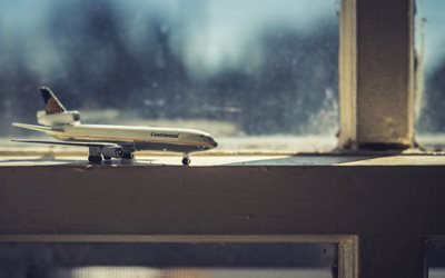 travel concepts, airplane on the windowsill, air travel, buying air tickets, travel planning