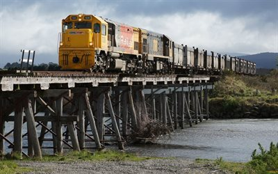 yellow locomotive, wooden bridge, cars