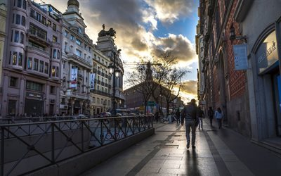 madrid, stone pavement, gloomy day, street, passers-by, spain