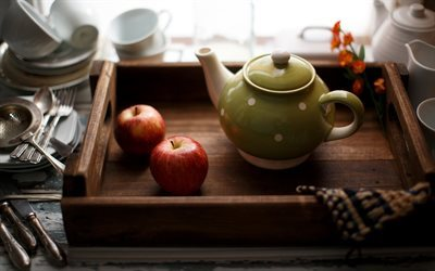 green teapot, wooden tray, apples