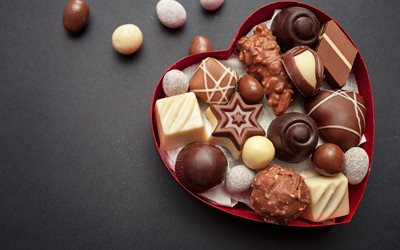 chocolates, sweets, various candies, white chocolate, gray background