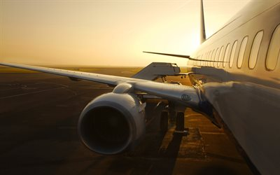 Airplane travel, sunset, passenger plane, aircraft wing, airport