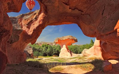Cappadocia, Turkey, orange rocks, sky, hot air balloon, flag of Turkey, rocks