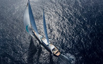 modern sailer, sea, white sails, top view, waves, yacht ride concepts