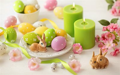 Painted Easter eggs, green candles, easter, spring, easter background, rabbits