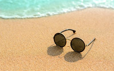 glasses on the sand, beach, sea, summer travel concepts, sand