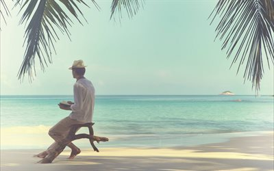 Tropical islands, travel, concepts, ocean, summer vacation, a man on the beach