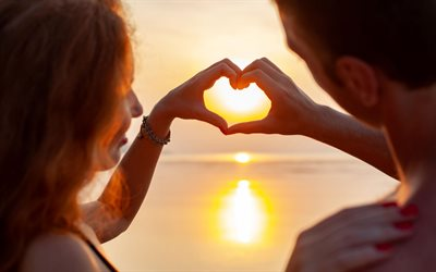 heart with hands of a couple, sunset, evening, love concepts, heart with hands, romance, couple