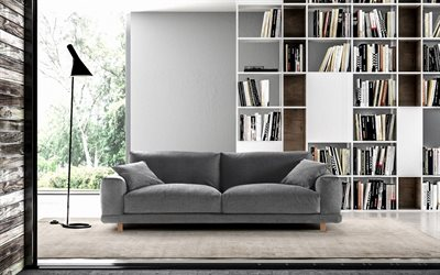 modern stylish interior, living room, loft style, large bookcase with books, home library, gray sofa, modern interior design