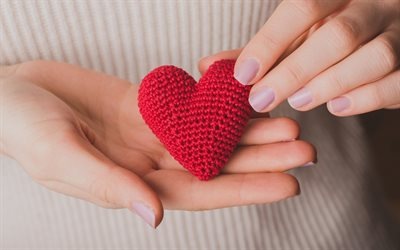 red heart in hands, knitted red heart, love concepts, romance, heart in female hands