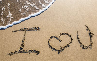 I love you, inscription in the sand, coast, wet sand texture, ocean, love concepts