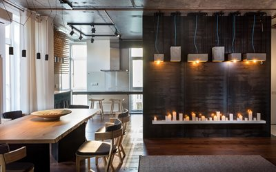 stylish interior design, dining room, loft-style interior, metal on the wall, candles, natural wood table, loft, modern interior