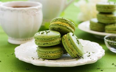 green macaroons, green cookies, macaroons, pastries, macarons on a plate, cakes