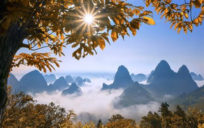 Guilin, Kweilin, mountain landscape, rocks, autumn, above the clouds, mountain peaks in the clouds, Guangxi Zhuang, China
