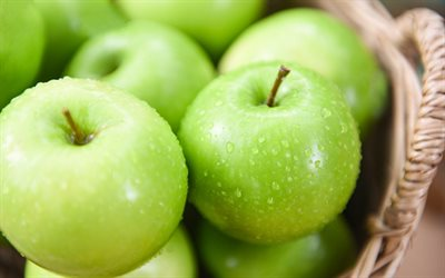 green apples, fruits, basket with apples, background with apples