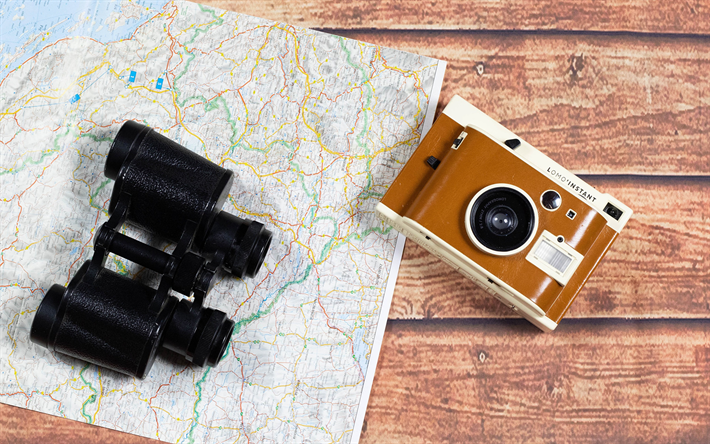 binoculars on the map, travel concepts, map, camera, things for travel