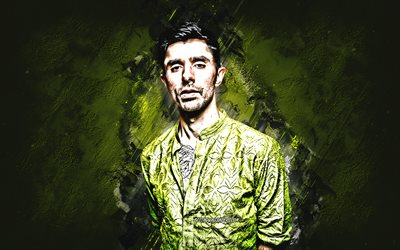KSHMR, Niles Hollowell-Dhar, american dj, portrait, green stone background, popular djs