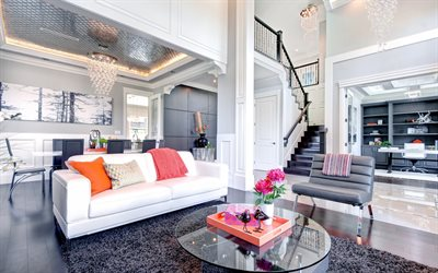stylish interior design, apartments, classical style, living room, white walls, crystal modern chandeliers, white leather sofa, two-storey apartment, dark brown wooden staircase in the apartment
