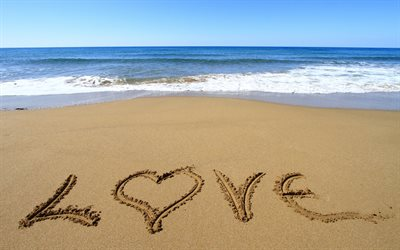 The word love in the sand, love concepts, sea, coast, waves
