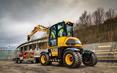 JCB 110W Hydradig, wheel excavator, construction machinery, new 110W Hydradig, pipe loading, modern excavators, JCB